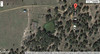 Google satallite map of ranch buildings and watering pond