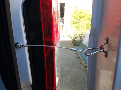 Tether to keep the door from over swinging.