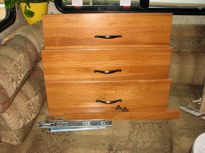 I wish I had weighed the drawers.  I know they were not lightweight.  I eventually gave all four drawers away in November - after repeatedly advertising on Freecycle and CraigsList.  They were pretty solid wood, so I was confident that SOMEONE would appreciate them.