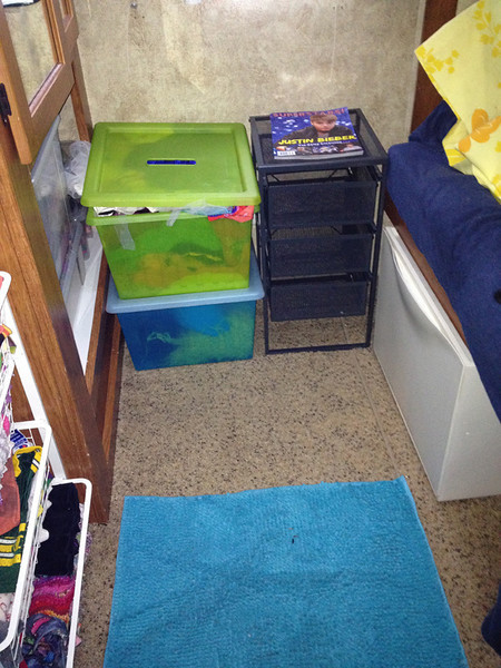 """Before: (well, slightly cleaned up) - but Molly and Zoe's toys were in these bins and drawers.  I thought the metal drawers would be awesome, but they ended up being played with and bent out of shape.  Do all kids use storage bins as toys?<br /> <br /> The only thing I haven't figured out is where to put the dress-up clothes (which are in that green box).  There are also too many stuffed animals - stored in that white bin on the right.  When we return to Houston, I want to get the stuffed animal """"bean bag"""" chair and the box of legos, but I'm not sure where they will be stored."""