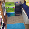 "Before: (well, slightly cleaned up) - but Molly and Zoe's toys were in these bins and drawers.  I thought the metal drawers would be awesome, but they ended up being played with and bent out of shape.  Do all kids use storage bins as toys?<br /> <br /> The only thing I haven't figured out is where to put the dress-up clothes (which are in that green box).  There are also too many stuffed animals - stored in that white bin on the right.  When we return to Houston, I want to get the stuffed animal ""bean bag"" chair and the box of legos, but I'm not sure where they will be stored."