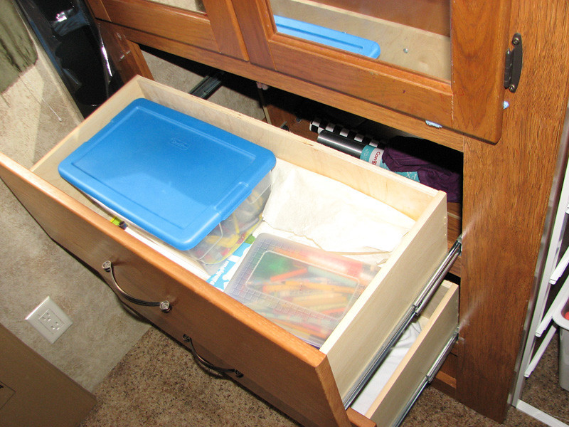 24.July.12 - The drawers in the bottom part of the cabinet are SOOOOOO small compared to the amount of space they take up.  So, Janis' solution is to yank them out!