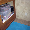 "After:  I prefer all things to be able to be put away neat and tidy.  The bins can be removed, if the kids want to play ""house"" with their dolls in the cubby hole.  But the best part is that they can all be put back in, like a puzzle, to give extra floor space or make it ready to put the slides in for travel.  There is room for more storage in this space, and it is much lighter weight storage than the drawers."