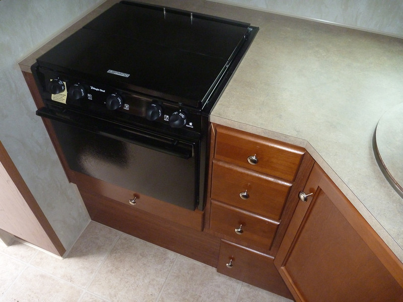 Propane stove and oven with ample drawer storage.