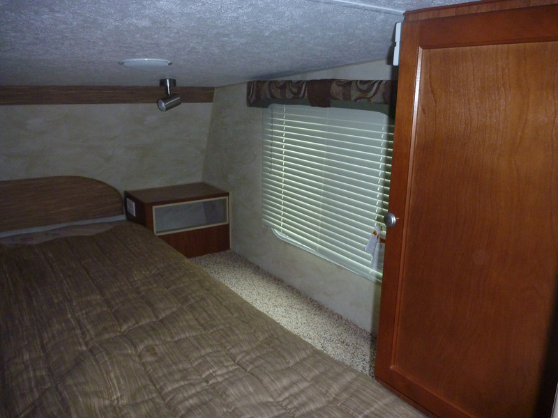 Large cabinet with hanger strip inside.