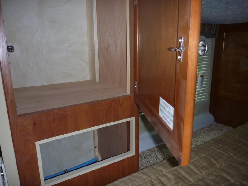 Storage cabinet and additional storage below.