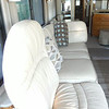 210--Passenger side wall, the passenger seat can be turned around, along with sofa (not a bed, but a drawer under it), makes a long nap sofa, or can lie there watching TV above the driver head..
