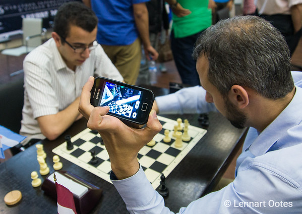 A chess player records his own game in the Rabat Blitz Tournament 2015.