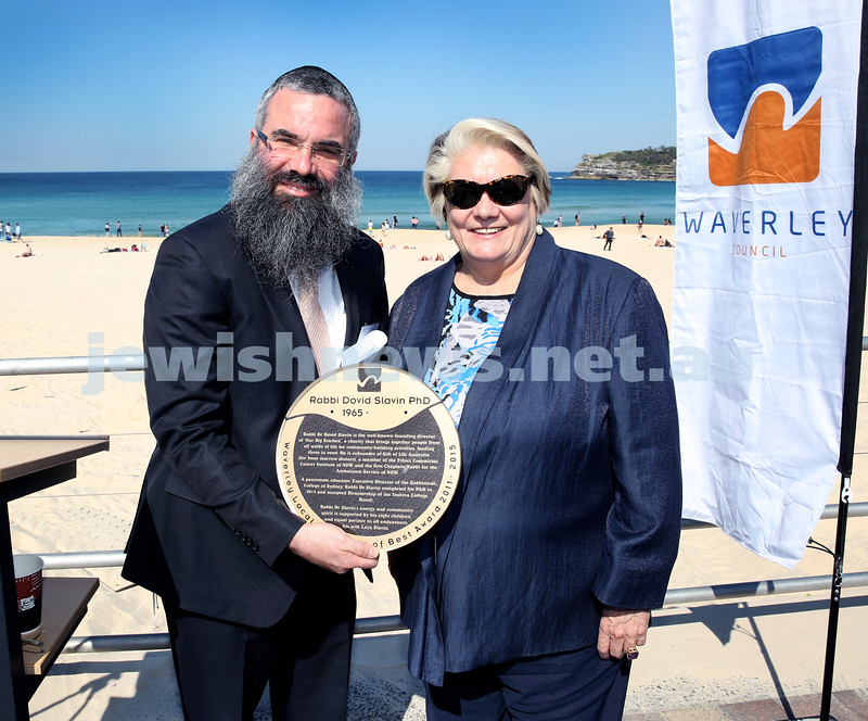 Rabbi Dovid Slavin honour plaque at Bondi Beach. Rabbi Slavin with Waverley Mayor Sally Betts. Pic Noel Kessel.