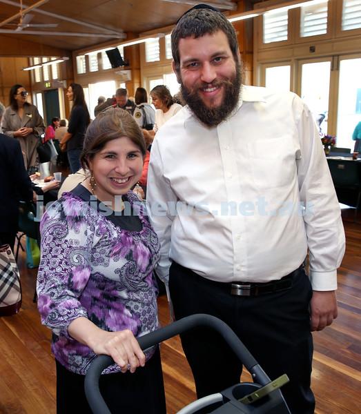 Rabbi Dovid Slavin honour plaque at Bondi Beach. Rivky and Rabbi Yossi Shuchat. Pic Noel Kessel.