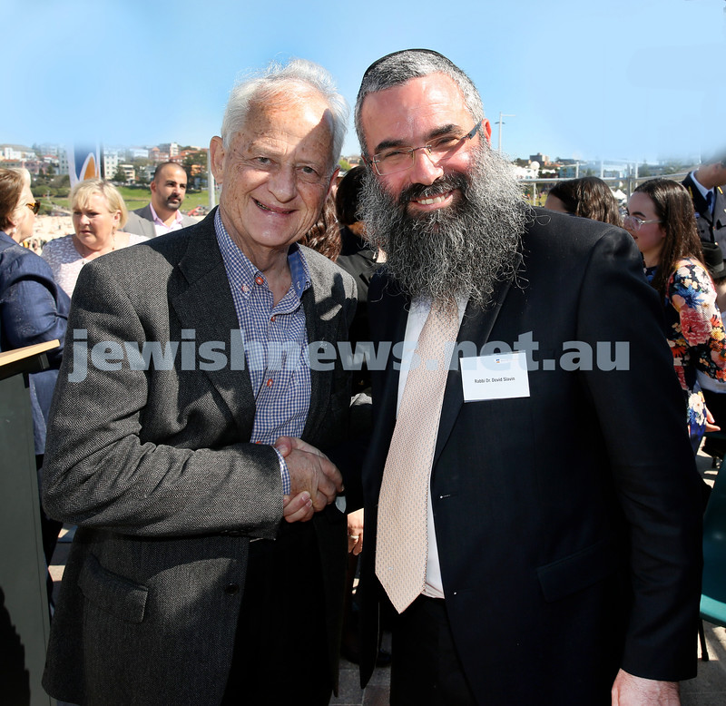 Rabbi Dovid Slavin honour plaque at Bondi Beach. Philip Ruddock (left) and Rabbi Dovid Slavin. Pic Noel Kessel.