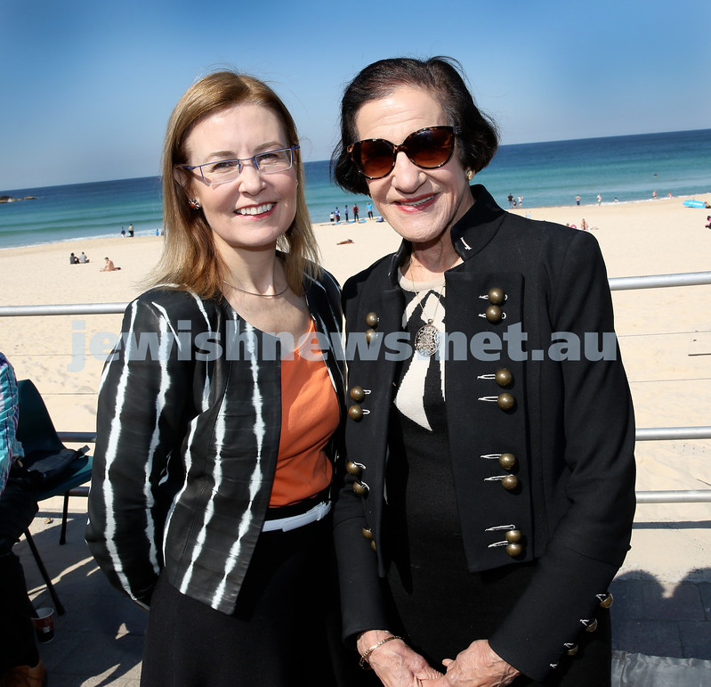Rabbi Dovid Slavin honour plaque at Bondi Beach. Gabrielle Upton MP (left) and Dame Marie Bashir. Pic Noel Kessel.