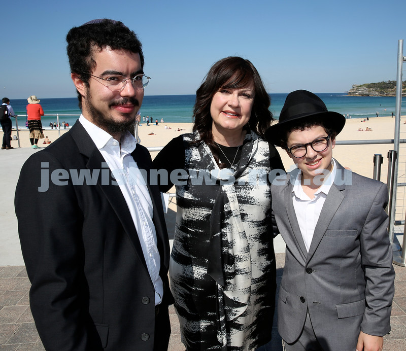 Rabbi Dovid Slavin honour plaque at Bondi Beach. Laya Slavin (middle) with her sons Mordi (left) and Shlomi (right). Pic Noel Kessel.