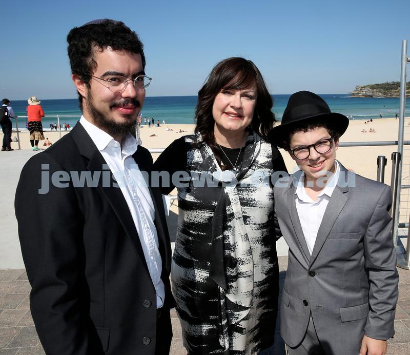 Rabbi Dovid Slavin honour plaque at Bondi Beach. Laya Slavin (middle) with her sons Mordi (left) and Shlomi (right). Pic Noel Kessel.