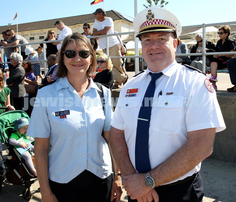 Rabbi Dovid Slavin honour plaque at Bondi Beach. Local SES Controller Kim Edwards (left) with NSW Ambulance Inspector James Porter. Pic Noel Kessel.