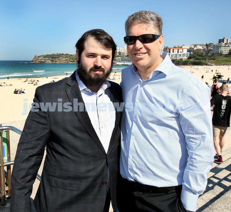 Rabbi Dovid Slavin honour plaque at Bondi Beach. Rabbi Elimelech Levy (left) and Kevin Krost. Pic Noel Kessel.