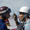 # 0 - 1957 FIA Fangio & Moss discussing test mule at Sebring