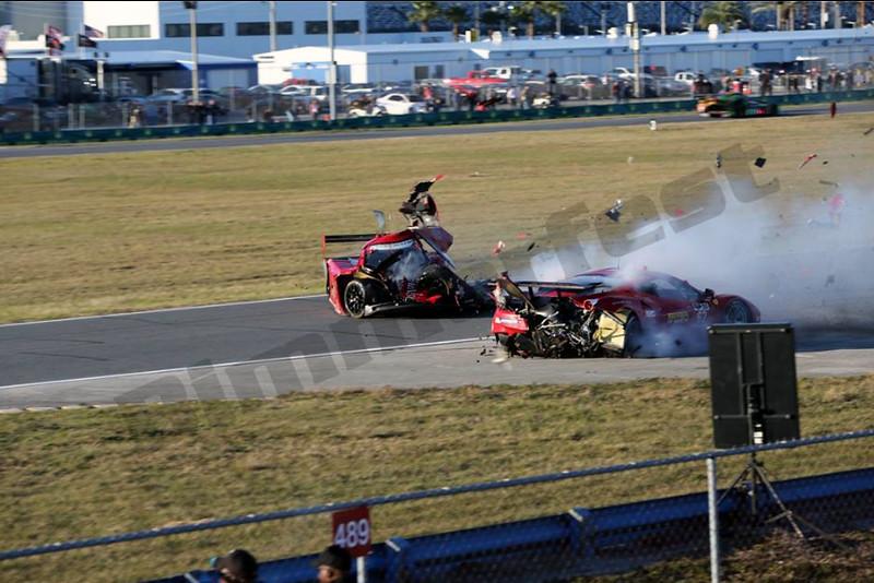 # 99 - 2014 USCR - Gainsco Corvette Memo Gidley hits Ferrari at Daytona - 02