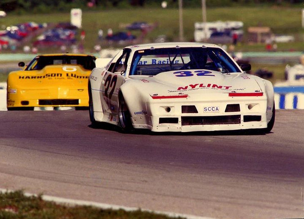 # 6 - SCCA GT1 1990 - Morris Clement Harrison Lumber trails Jerry Dunbar at Road America turn 6 Jun Sprints
