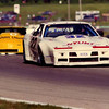 # 6 - SCCA GT1 1990 - Morris Clement Harrison Lumber trails Jerry Dunbar at Road America turn 6 Jun Sprints