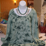This blouse and necklace comprised a silent auction package.