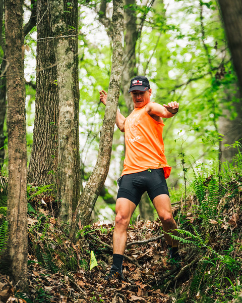 Jason flying down a ravine during a trail race