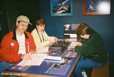 Friday, April 23rd, 2004.  Our adventure in Monterey started at the Monterey Bay Aquarium, where we colored shark hats for ourselves.