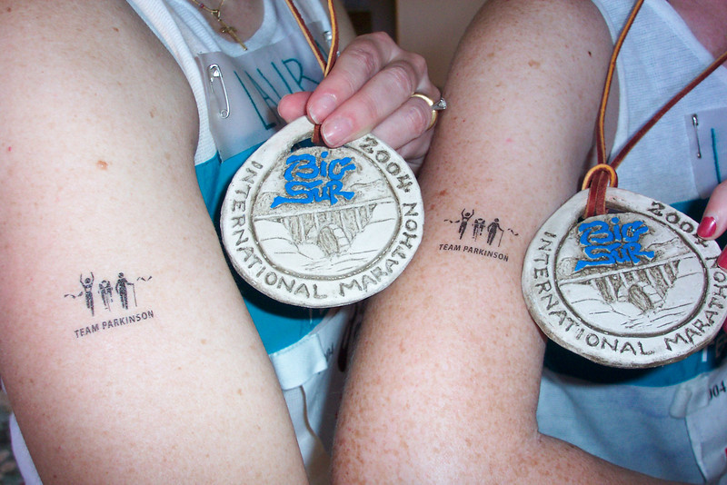 Laura and Linda admire their medals and show off their Team Parkinson tattoos.  We collectively raised about $1800 for Parkinson's research.