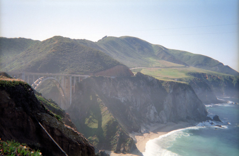 Patti takes a photo showing Bixby Bridge from the other side, with a good view of Hurricane Point.  She's quite happy to be finished with it.