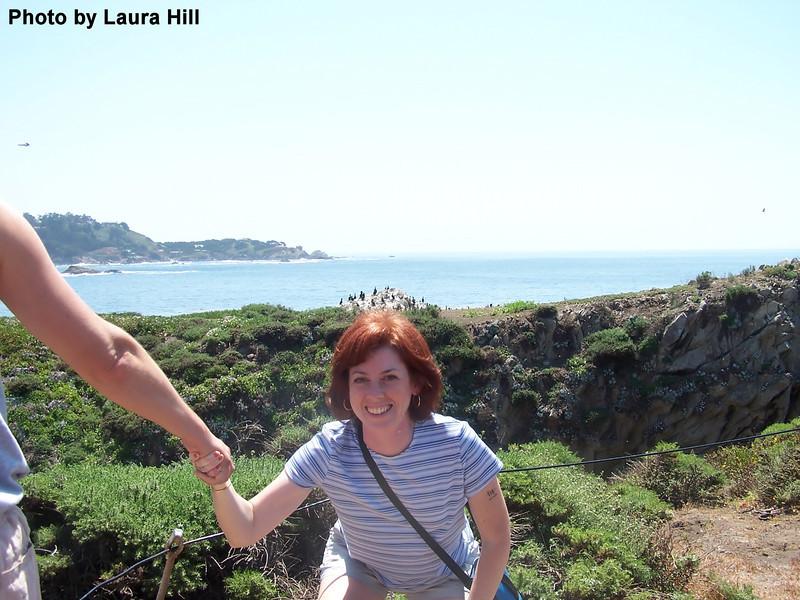 Linda has a bunch o'birds on top of her head!