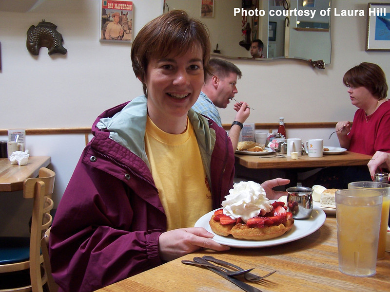 Saturday, April 24th, 2004.  We consumed an enormous breakfast in Monterey.  Laura shows off the excessive amount of whipped-cream on her waffle.