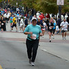 Jeane's in a decently big crowd of other half-marathon participants as she nears the finish.