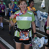 Laura picks up her Mickey Mouse medal for finishing the marathon.