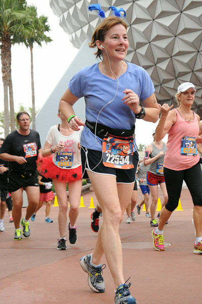 Laura, feeling good 'cause she's at Epcot so there can't be much more race left!