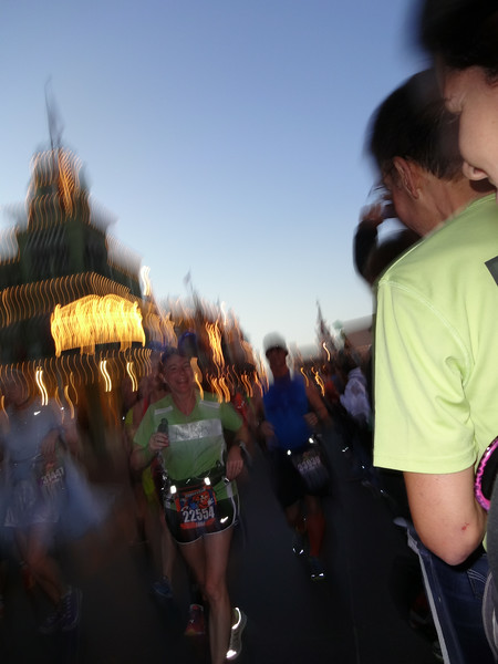 A very blurry Laura (must be her blazing speed) comes up Main Street USA.