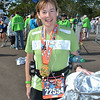 """Laura models her third medal of the weekend...her reward for having completed the """"Goofy Challenge"""" -- a half-marathon followed by a marathon."""