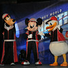 Goofy, Mickey, and Donald provide commentary for the runners as we approach the starting line.