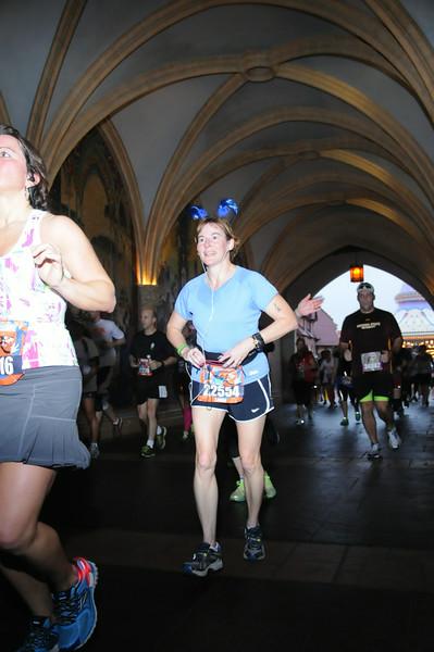 Laura passes through Cinderella's Castle.