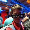 Patti models her 3D glasses as we wait in line for Star Tours.