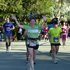 And Laura's little head-bobbers and flashy shirt help us spot her among the other thousands of runners.