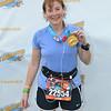 Laura models her Donald Duck half-marathon medal.