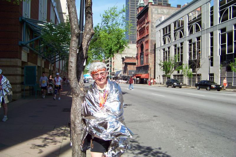 Jeane showing off her mini-marathon medal.