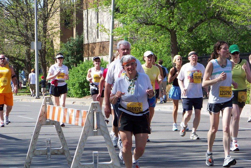 Coming down the homestretch about 13 miles into the race.  Jeane looks like she is no longer having fun.