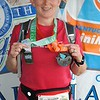 "Patti gets an extra medal because she completed the ""Kentucky Half Classic"", which involved finishing Lexington's Run the Bluegrass half-marathon a month earlier."