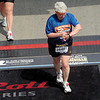 Darn that Jeane -- always stopping to check her watch instead of smiling for the nice finish-line photographer!