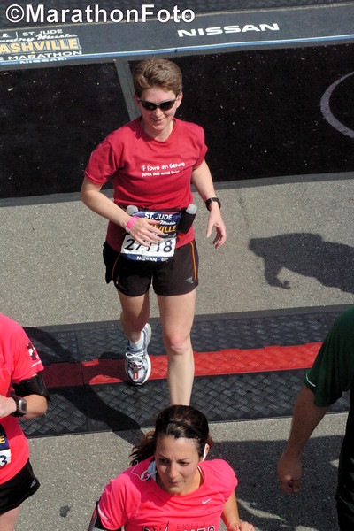 Patti, just crossing the finish line mat.