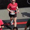 Patti, just crossing the finish line mat.