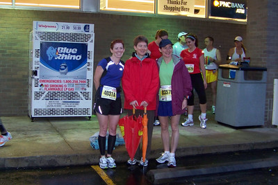 It's raining, and not very light outside yet.  Linda, Patti, and Laura are psyched about running another race in wet shoes!