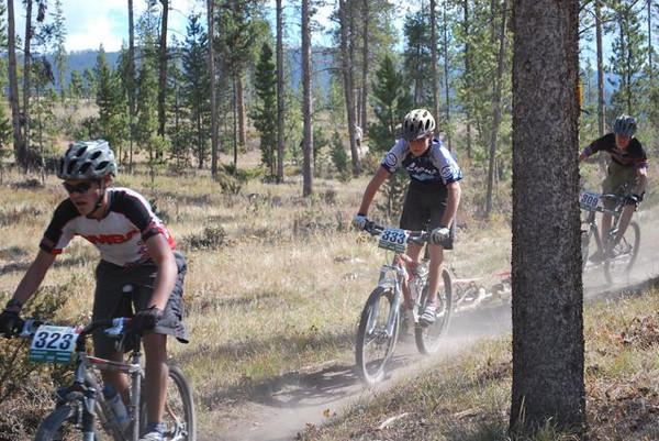 Junior Varsity riders Max Neuman (Fairview HS), Alex Willie (Lyons HS), and Jack Dean (Boulder HS) battle it out.