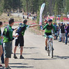 James Lipe (Colorado Rocky Mountain School) takes a bottle from his team in the Junior Varsity Boys race.
